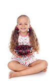 Girl holding a bowl of ripe cherries Royalty Free Stock Photos