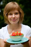 Girl holding a bowl of strawberries Royalty Free Stock Photos