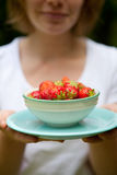 Girl holding a bowl of strawberries Stock Photo