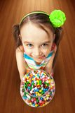 Girl holding a box of candies Stock Photo