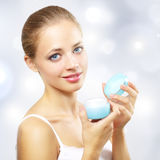 Girl holding a box of cosmetic cream Stock Image