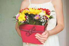 Girl holding a box of flowers. Stock Images