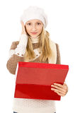 Girl holding a box and wondering Royalty Free Stock Image