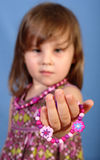 Girl holding bracelet Royalty Free Stock Images