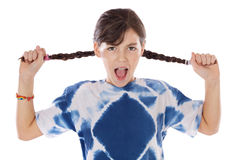 Girl holding braids and shouting Stock Photography