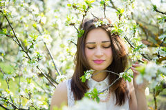 Girl holding a branch of a flowering tree Stock Photos