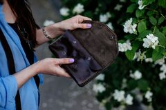 Girl holding a brown money wallet. stock photos