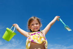 Girl holding bucket and spade Stock Photos