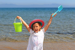 Girl holding bucket and spade Stock Image