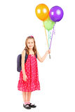 Girl holding a bunch of balloons Stock Photography