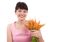 Girl holding bunch of carrots Royalty Free Stock Images