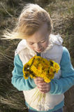Girl Holding Bunch Of Flowers Outdoors Stock Images