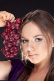 Girl Holding Bunch Of Red Grapes Stock Photography