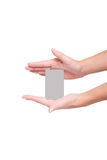 Girl holding a business card. Girl hand holding a business card Royalty Free Stock Photo