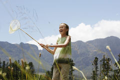 Girl Holding Butterfly Net Royalty Free Stock Image