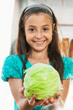 The girl is holding the cabbage Stock Image