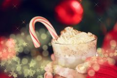 Girl holding cacao with whipped cream and peppermint candy cane. Christmas holiday concept. Holiday background. Holiday or winter background. Horizontal, with royalty free stock photos