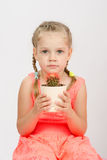 Girl holding a cactus keeps Stock Photography