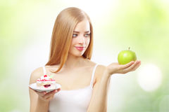 Girl holding a cake and apple Stock Photos