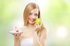 Girl holding a cake and apple Royalty Free Stock Image