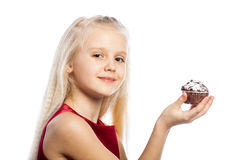 Girl holding a cake and looking in camera Royalty Free Stock Images