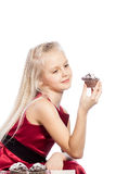 Girl holding a cake and looking in camera Stock Photo