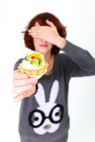 Girl holding a cake and shutting her eyes Stock Photo