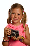 Girl holding camera Stock Image