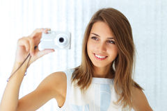 Girl holding a camera Royalty Free Stock Images