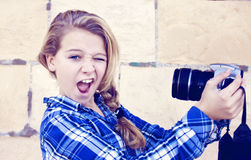 Girl holding camera Royalty Free Stock Photos