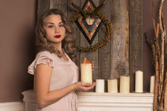 Girl holding a candle. Beautiful girl holding a candle Royalty Free Stock Image