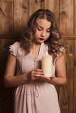 Girl holding a candle. Beautiful girl holding a candle Stock Photo