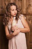 Girl holding a candle. Beautiful girl holding a candle Stock Images