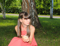 Girl holding a candle and looking away Royalty Free Stock Image