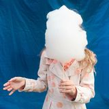Girl holding the candyfloss. Portrait of girl holding the candyfloss before her head Royalty Free Stock Images