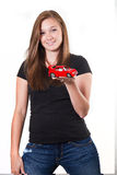 Girl holding a car Stock Images