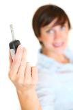 Girl holding car key Royalty Free Stock Images