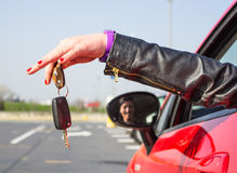 Girl is holding car key Stock Image