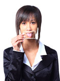 Girl holding a card with photo her tongue Royalty Free Stock Image