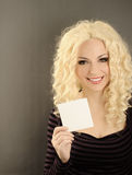 Girl holding a card Stock Image