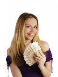 Girl holding cash Stock Photo