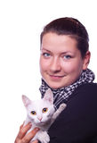 Girl holding a cat. Cute girl holding a little white cat Royalty Free Stock Photography