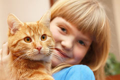 Girl holding cat Stock Photo
