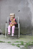 Girl holding a cat. Girl sitting on a camping chair holding a ginger cat. Space for text Stock Images