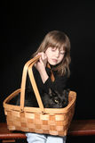 Girl holding cat in basket Royalty Free Stock Photo