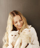 Girl holding cats Stock Photography