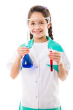 Girl holding chemical flask. Smiling girl in protective wear holding a chemical flask and test tube, isolated on white Royalty Free Stock Photo