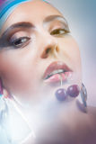 girl holding a cherry Royalty Free Stock Photography