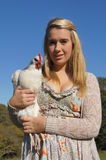 Girl Holding Chicken. Pretty girl holding a white Sussex-Light chicken Stock Images