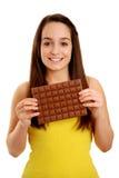 Girl holding chocolate bar Royalty Free Stock Photo